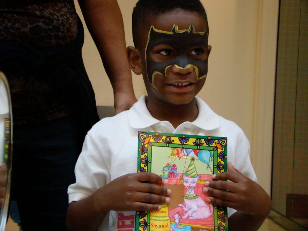 A Boy holding It's Your Birthday Shyann!